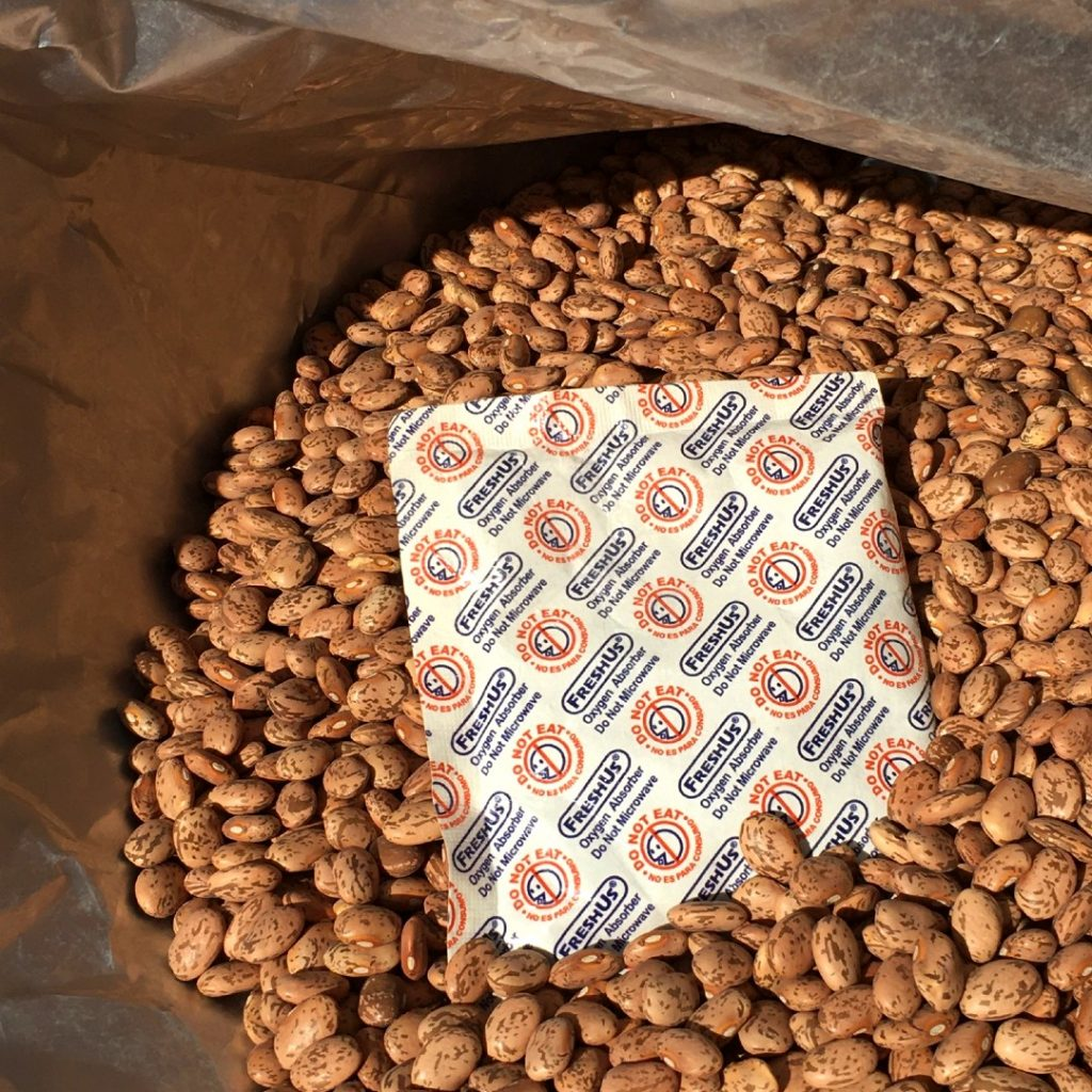 Bulk beans for long term storage with oxygen pack